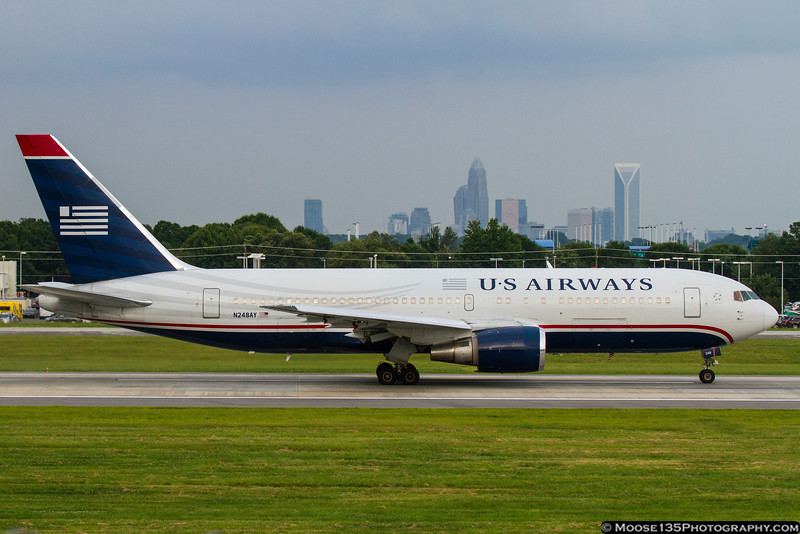 August 9 - US Airways preparing to depart as the storm clouds gather.