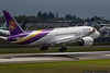 September 8 - The sun pokes through just as this Thai 787 lands at Paine Field, on a Boeing test flight.