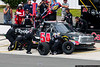 """August 2 - Darrell """"Bubba"""" Wallace makes a quick pit stop in the NASCAR Truck Series race at Pocono ."""
