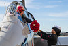 December 7 - Sailor presents a bouquet of roses to be dropped over the Statue of Liberty to commemorate 73rd anniversary of the Pearl Harbor attack.