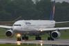 June 27 - Lufthansa A340 prepared to depart in a rain storm.