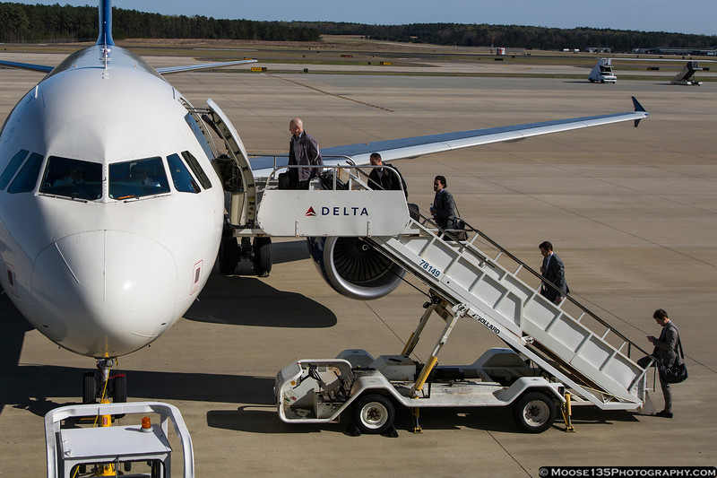 April 4 - Members of the Philadelphia Flyers NHL team boards a Delta A319 at Raleigh-Durham Airport, following a game against the Carolina Hurricanes.