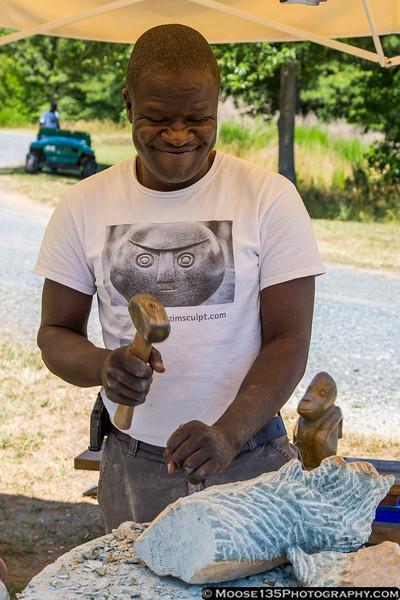 June 28 - Artist Passmore Mupindiko from Zimbabwe works on a piece as part of the ZimScuplt exhibit at Daniel Stowe Botanical Gardens.