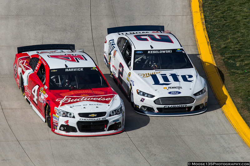 March 29 - In a battle of the beer cars, Brad Keselowski moves past Kevin Harvick at Martinsville.