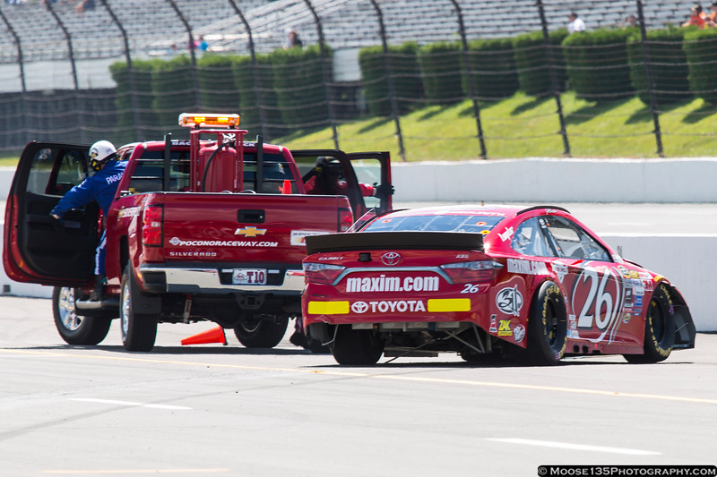 August 1 - Safety crews respond to the car of Jeb Burton at Pocono Raceway.  During Sprint Cup practice, Burton spun off Turn 3 and skidded into the pits, hitting the inside pit wall about 20 feet past me.  Burton was uninjured in the wreck, but was forced to a backup car.