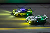 January 31 - Cars take to the high banks in the early morning hours of the Rolex 24 Hours of Daytona.