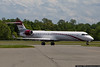 April 30 - Joe Gibbs Racing CRJ-700 at Concord Regional Airport, waiting to pick up the race team following a race in Richmond, VA.