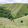 Patches of blue sky appear as we head for early morning in Dovedale before the madding crowds.