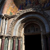 Marble columns frame the entrance to St Mark's Basilica