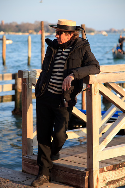 Distinctive striped shirt and straw hat - uniform of the Gondoliers