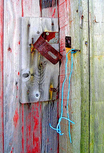 an old, rusty hasp on an old barn
