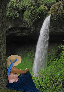 a woman sitting near and watching a waterfall, a woman sitting near and watching a waterfall