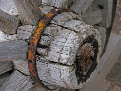a broken old wooden wagon wheel