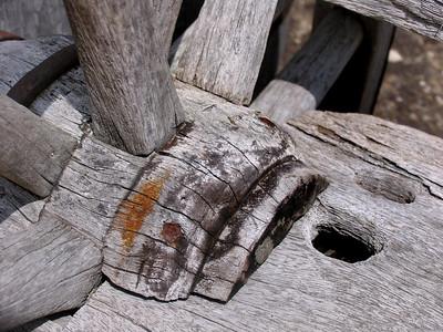 a broken old wooden wagon wheel