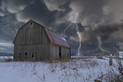 an old abandoned farm in a storm