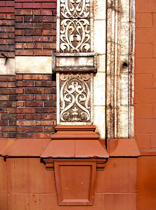 detail of a design on a brick building, detail of a design on a brick building