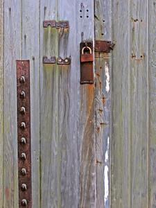 wooden barn door with rusty lock