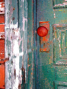 a very old door on an abandoned house, a very old door on an abandoned house