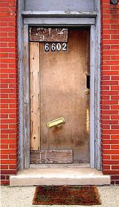 a strange door with a doormat, a strange door with a doormat