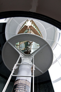 The Fresnel lens at the top is two sided so that the light would flash every 10 seconds (as the entire assembly completed one rotation every 20 seconds). Each lighthouse in the Great Lakes flashed at a unique frequency so the ship operators would know which one they were seeing.