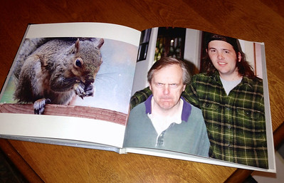 "12/30 - The word of the day is ""juxtaposition"". Aubrey and Drew made us this cool photo book with shots of our family and some of my favorite wildlife photos. They designed it carefully. For example, this picture of Frank scowling is opposite the picture of a squirrel. Frank HATES squirrels. Clever placement, kids, and a very special gift!"
