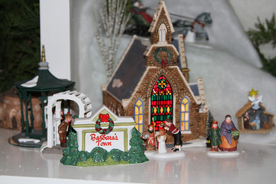 12/14 - My Christmas Village is finally up. Here's just a part of it - may favorite church, and this year's invention, a snow bank that covers the cord case. My village is called Barbara's Town after my Mother-in-Law, because most of it comes from her collection.