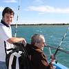 12/21 - We went on a fishing trip this afternoon. Not a catching trip. but a lovely ride on the water. Frank always loves fishing, even when the weather is cold and the fish are elsewhere. Love this shot of him and John manning their fishing poles.