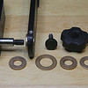 "Camera support arm with 1/2"" x 1"" shoulder bolt; 1/8"" x 1/2"" ID thrust bearing; upright with 1/2"" ID x 3/4"" OD x 5/16"" flat x 1/8"" flange bearing; 1/16"" x 3/4"" ID thrust bearing; 1/8"" x 1/2"" ID thrust bearing; 1/16"" x 1/2"" ID thrust bearing; tension adjustment knob and locking knob."