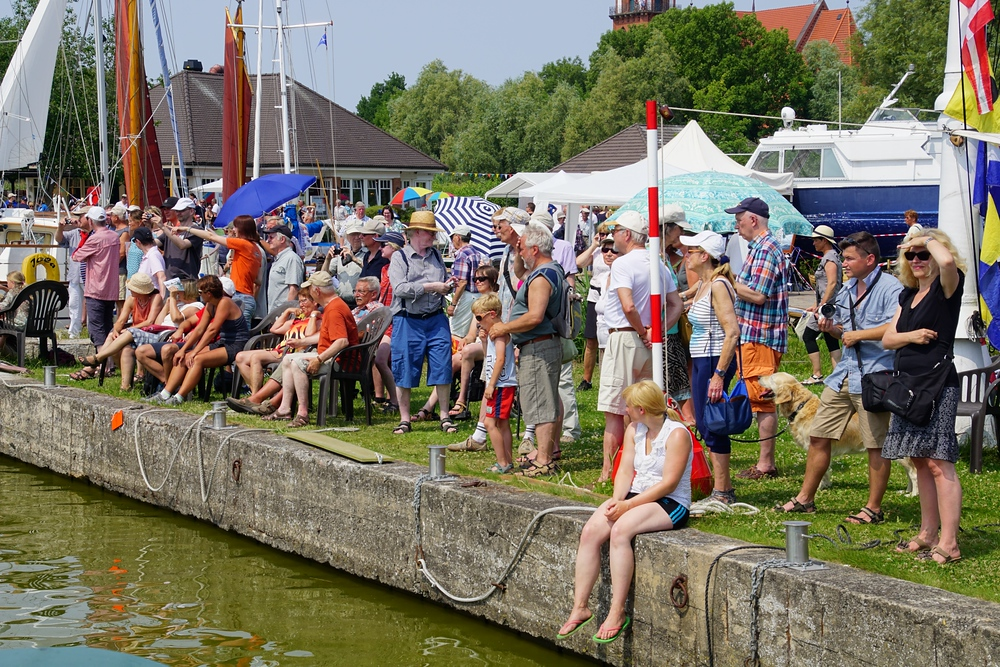 A crowd of lively German spectators cheering on participants of the Regatta in Wustrow, Germany.
