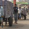 A group of Bangladeshi men haul a heavy load on a cart - Old Dhaka, Bangladesh.