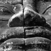 Massive stone face smile up close at Bayon, Angkor Thom.