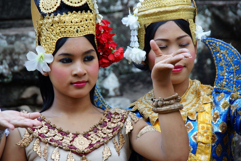 Traditional Khmer dances wearing elaborate costumes greet tourists at Bayon.