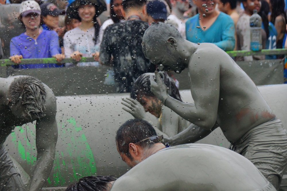 Mud flying everywhere!  This mud wrestling event covered the crowd just as much as the participants.  I'm certainly glad I wrapped my dSLR in plastic.