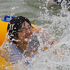 Splish splash, a Korean lady is getting soaked in a water fight with her friend.