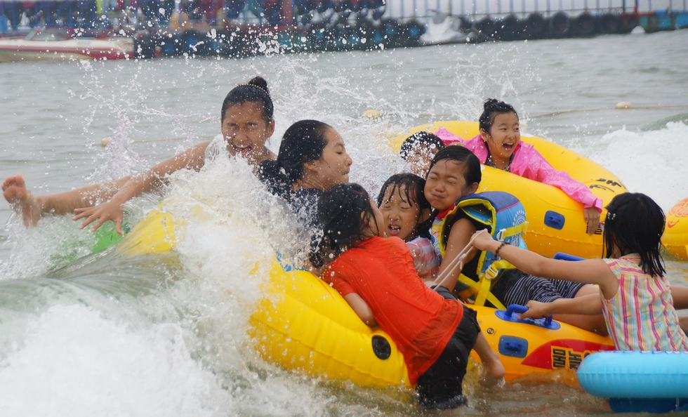 A group of Korean girls are toppled by the wave.