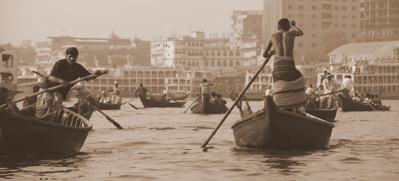 "This was a typical scene along the Buriganga River near the Sadarghat with small vessels weaving in and out along the chaotic waters:<br /> <a href=""http://nomadicsamuel.com/photo-essays/boat-buriganga-sadarghat-dhaka-bangladesh"">http://nomadicsamuel.com/photo-essays/boat-buriganga-sadarghat-dhaka-bangladesh</a>"