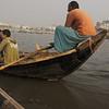 """The rowboat you see in front of us is nearly identical to the one I've just boarded:<br /> <a href=""""http://nomadicsamuel.com/photo-essays/boat-buriganga-sadarghat-dhaka-bangladesh"""">http://nomadicsamuel.com/photo-essays/boat-buriganga-sadarghat-dhaka-bangladesh</a>"""