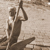 """An oarsman with a stern face and white beard glares at me as we pass his vessel:<br /> <a href=""""http://nomadicsamuel.com/photo-essays/boat-buriganga-sadarghat-dhaka-bangladesh"""">http://nomadicsamuel.com/photo-essays/boat-buriganga-sadarghat-dhaka-bangladesh</a>"""