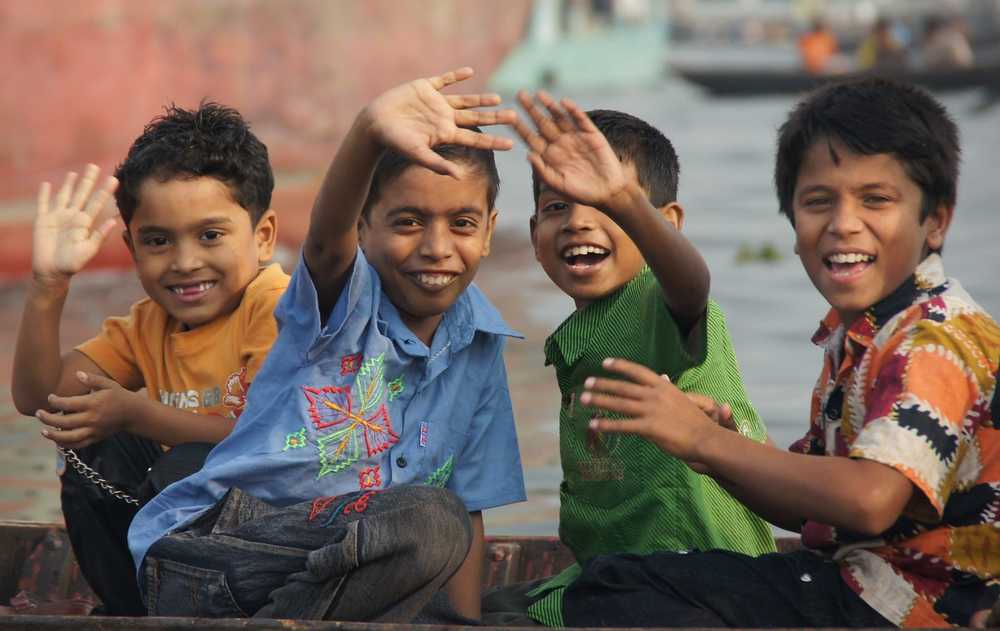 A group of adorable Bangladeshi boys wave to me as I take their photo.
