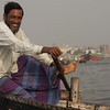"A Bangladeshi man, an oarsman on a small vessel, flashes a wonderful radiant smile; one of many smiles that would make my day:<br /> <a href=""http://nomadicsamuel.com/photo-essays/boat-buriganga-sadarghat-dhaka-bangladesh"">http://nomadicsamuel.com/photo-essays/boat-buriganga-sadarghat-dhaka-bangladesh</a>"
