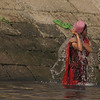 """Bangladeshi women splash water on their faces nearby a less crowded ghat:<br /> <a href=""""http://nomadicsamuel.com/photo-essays/boat-buriganga-sadarghat-dhaka-bangladesh"""">http://nomadicsamuel.com/photo-essays/boat-buriganga-sadarghat-dhaka-bangladesh</a>"""
