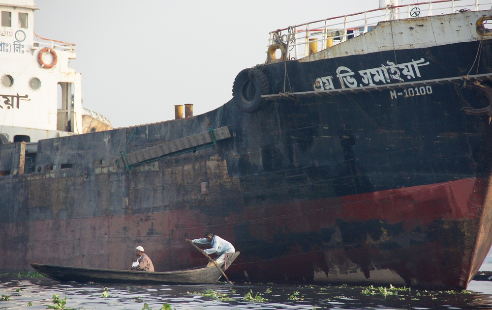 This photo should give you a sense of the sheer size of the large vessels in comparison to the smaller passenger rowboats that all share space along the Buriganga.