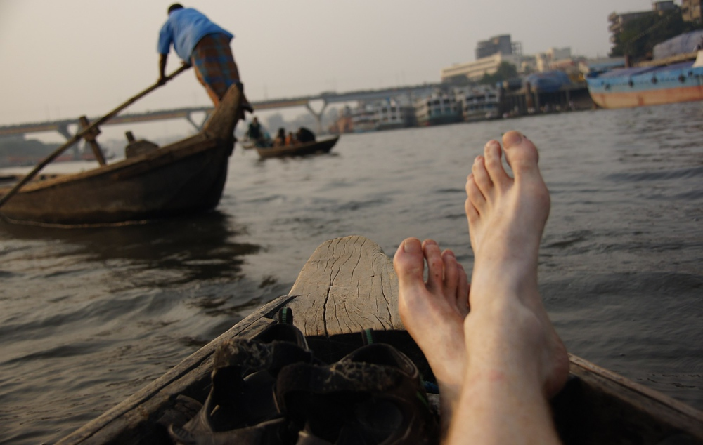 Here I am relaxing on the rowboat as we pass numerous other small vessels nearby the Sadarghat.