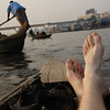 """Here I am relaxing on the rowboat as we pass numerous other small vessels nearby the Sadarghat:<br /> <a href=""""http://nomadicsamuel.com/photo-essays/boat-buriganga-sadarghat-dhaka-bangladesh"""">http://nomadicsamuel.com/photo-essays/boat-buriganga-sadarghat-dhaka-bangladesh</a>"""