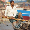 """The button down shit and lungi (Bangladeshi skirt for men) are typical attire for Bangladeshi men - especially the oarsmen:<br /> <a href=""""http://nomadicsamuel.com/photo-essays/boat-buriganga-sadarghat-dhaka-bangladesh"""">http://nomadicsamuel.com/photo-essays/boat-buriganga-sadarghat-dhaka-bangladesh</a>"""