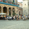 People enjoy the sounds of lively Cuban music in a sun drenched Havana square...