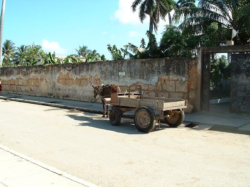 An empty wagon symbolizes the simple life of the rural people.