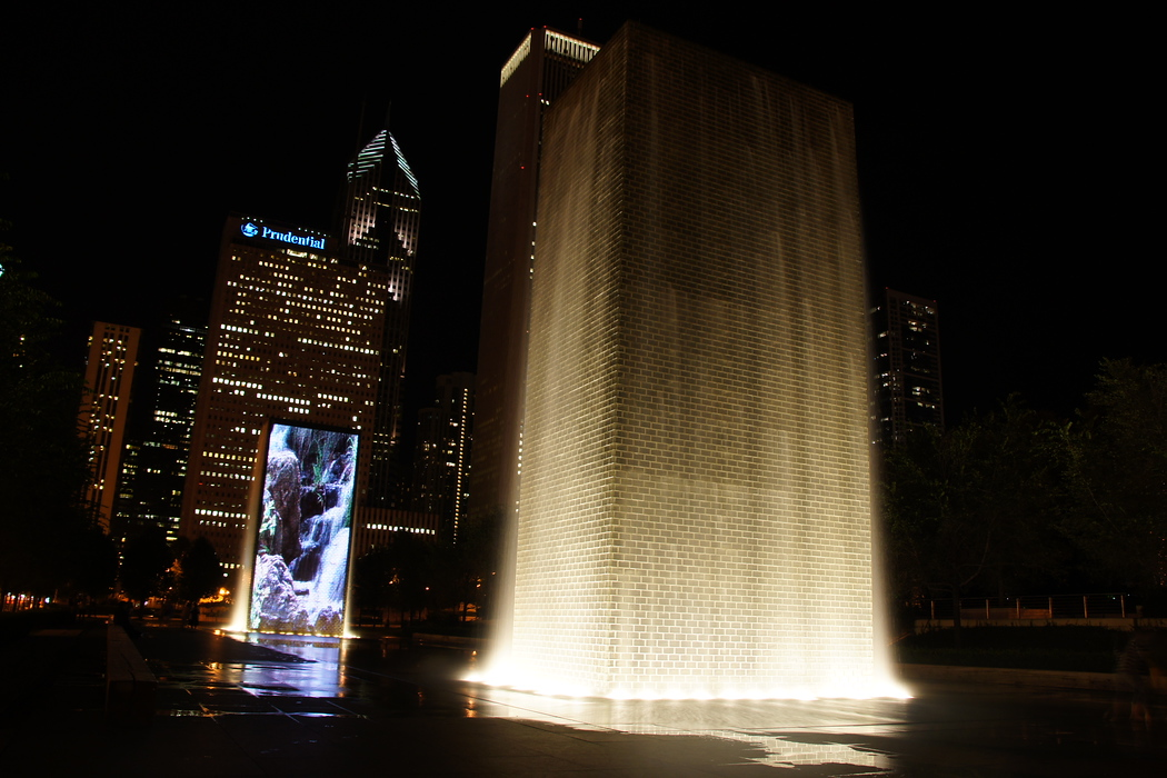http://nomadicsamuel.com/destinations/chicago-at-night-photo-essay : I ventured back to the Crown Fountain late at night when nobody else was around.  I had this view all to myself.