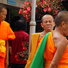 A Thai monk sticking out his tongue and acting silly - Chiang Mai, Thailand.