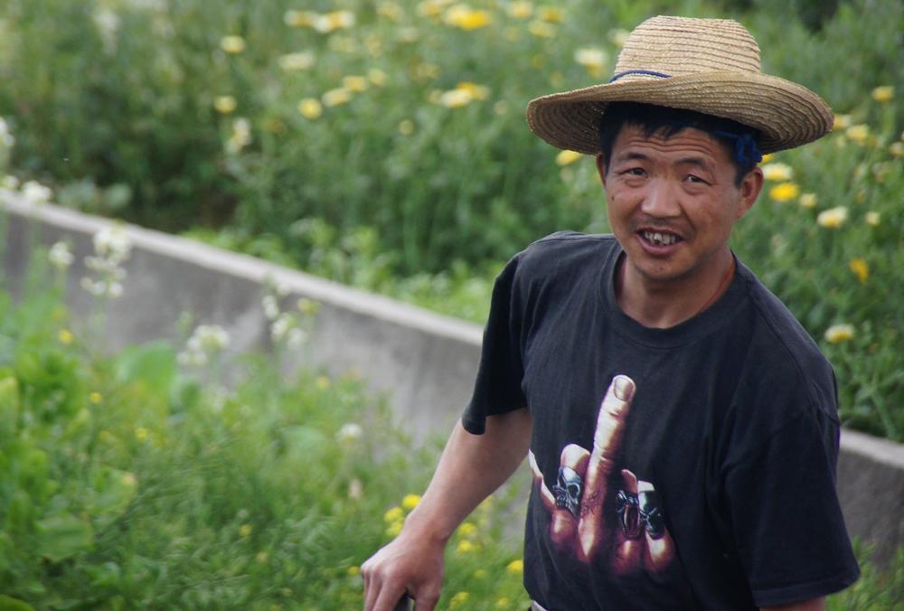 A Chinese farmer wearing a fuck you t-shirt - Dali, China.